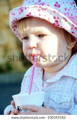 child with drink - stock photo