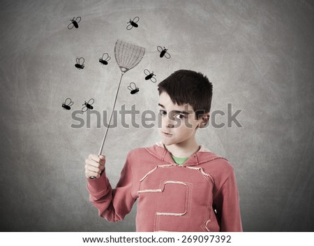 child with expression shooing flies - stock photo