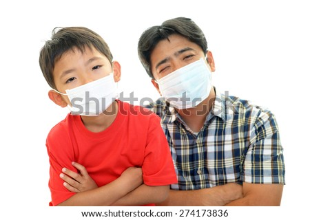 Child with father having cold - stock photo