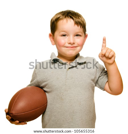 Child with football celebrating by showing that he's Number 1 isolated on white - stock photo