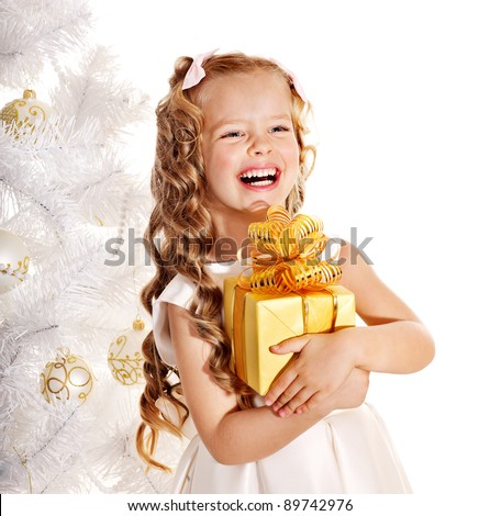 Child with gift box near white Christmas tree. Isolated. - stock photo