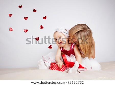 Child with hearts flying out of box isolated on white