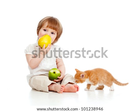 child with kitten and healthy food apples - stock photo