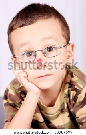 Child with lenses thinking and looking at camera