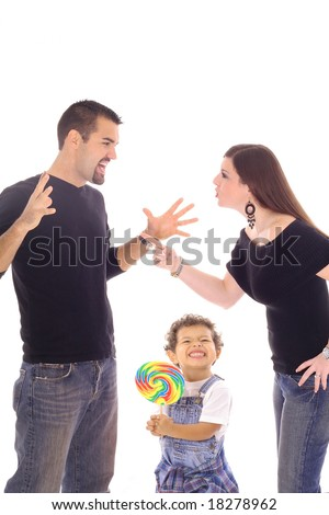 child with lollipop caught in the middle - stock photo