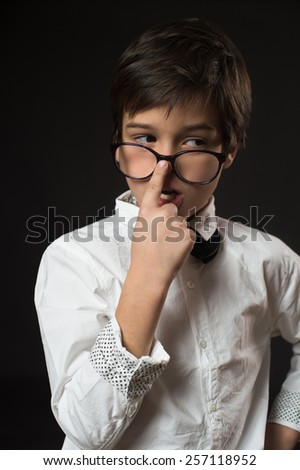 Child with low vision wearing glasses  - stock photo
