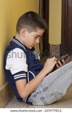 child with mobile phone indoors, technology