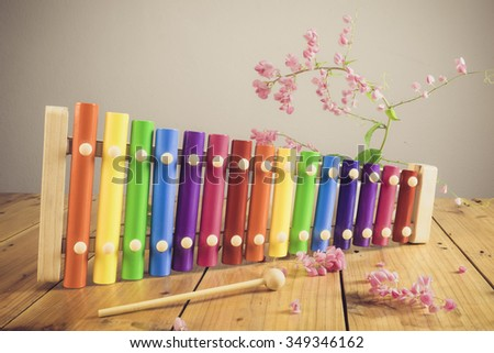 Child with music instruments. Musical education for kids. Colorful wooden art toys for kids. - stock photo