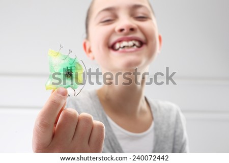 Child with orthodontic appliance.Portrait of a little girl with orthodontic appliance  - stock photo
