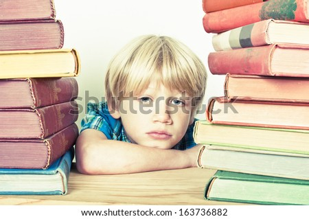 Child with pile of books