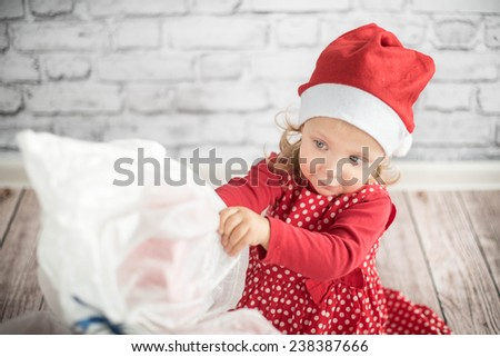 Child With Present Gift Box - stock photo