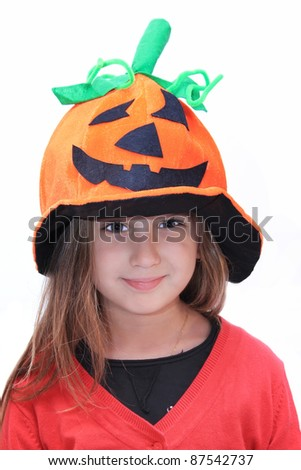 child with pumpkin hat - stock photo