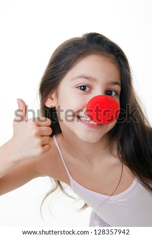 child with red clown nose thumbs up - stock photo