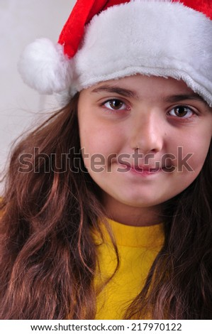 Child with Santa Claus red hat. Christmas, New Year celebration - stock photo