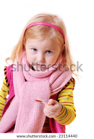 child with syrup in a spoon - stock photo