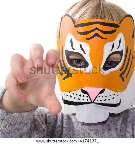 child with tiger mask. kid pretending to be wild animal. toddler dressed up playing and isolated on white - stock photo