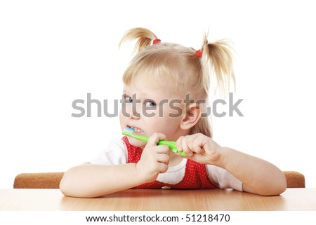 child with toothbrush in hands