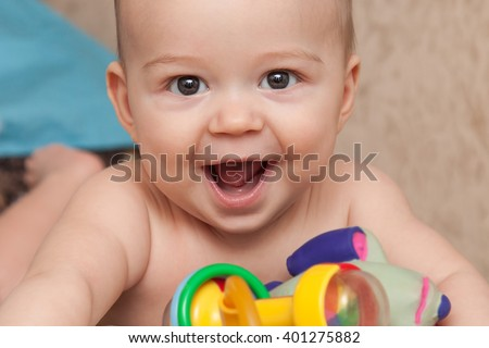 Child nibbling his fist stock photo 388108249 shutterstock
