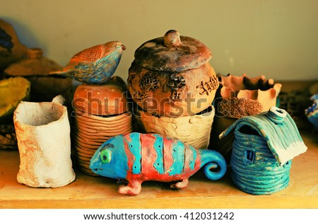 child work, pottery, ceramics, toy bird and chameleon