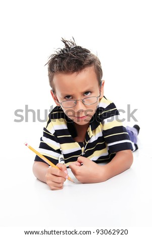 Child writing and looking at the camera, angry gestures