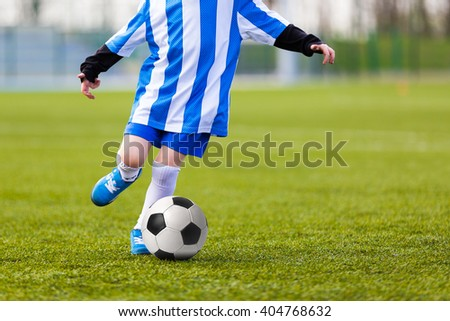Child Young Boys Kicking Soccer Ball. Kid Playing Soccer. - stock photo