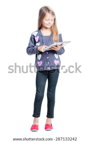 Childhood and technology. Full length of pretty little girl using tablet computer. Isolated on white. - stock photo
