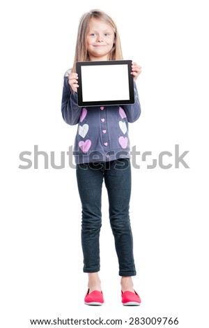 Childhood and technology. Your text here. Full length of cute little girl holding tablet computer with copy space on screen. Isolated on white. - stock photo