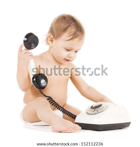 childhood and toy concept - curious child playing with phone - stock photo
