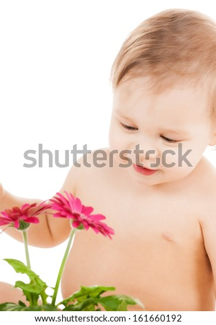 childhood and toys concept - cute little boy playing with flower - stock photo