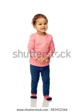 childhood, fashion, clothing and people concept - smiling beautiful african american little baby girl walking - stock photo
