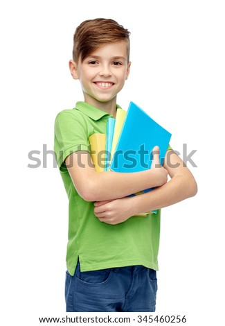childhood, school, education and people concept - happy smiling student boy with folders and notebooks - stock photo
