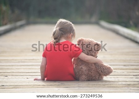 Childhood secrets are best shared with reliable friend. And if you are small sad girl teddybear is willing to be your perfect friend. - stock photo