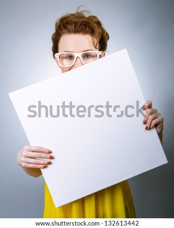 Childish woman with white blank board - stock photo
