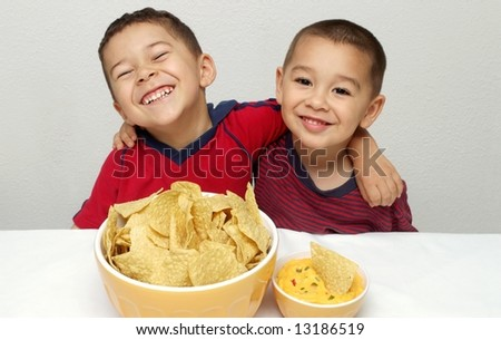 Children and chips - stock photo