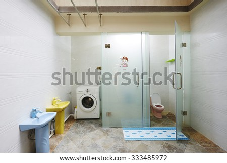 Children and Family home interiors,kindergarten bathroom with washbasins and cabins without children