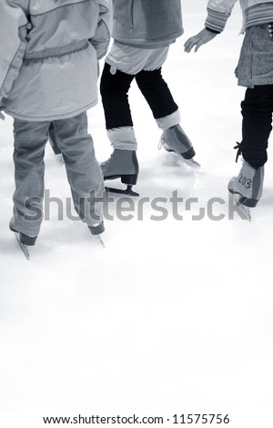 Children are Learning Ice-skating at Ice Rink - stock photo