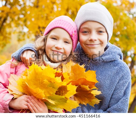 Children at autumn. Girls and boy outdoors