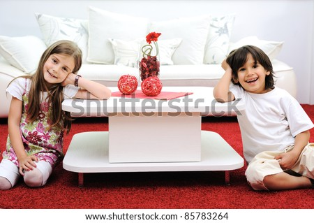 Children at new home with modern furniture - stock photo