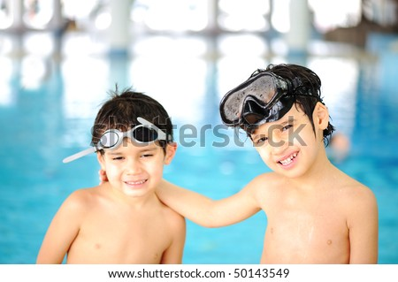 Children at pool, happiness and joy - stock photo