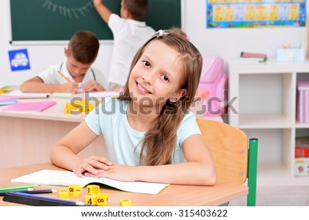 Children at the desks in classroom