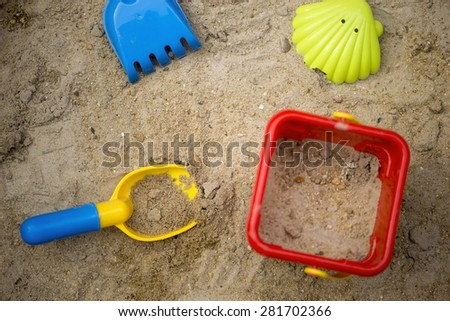 Children beach toys in the sand - stock photo