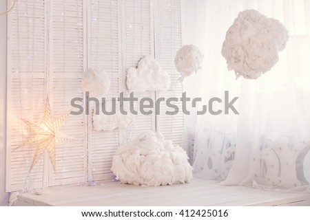 Children bedroom. kids room with light white decoration, clouds and sun  - stock photo
