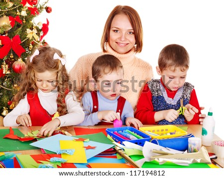 Children boy and girl making Santa card for Christmas. - stock photo