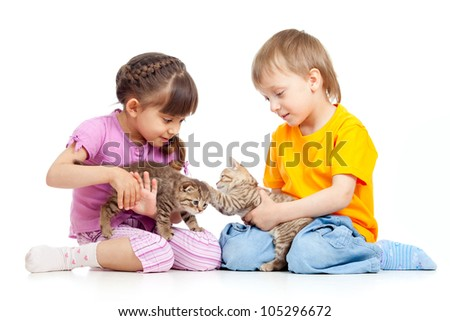 Children boy and girl playing with kittens. Isolated on white background - stock photo