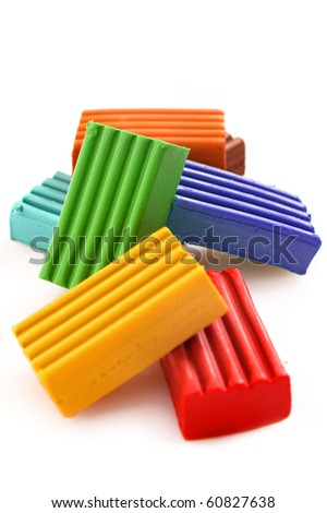 Children bright coloured plasticine set chaotically isolated on white - stock photo