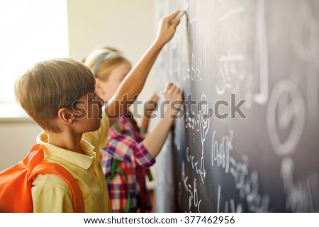 Children by blackboard