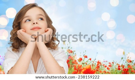 children, childhood, nature, summer and happy people concept - beautiful girl looking up and dreaming over poppy field and lights background - stock photo
