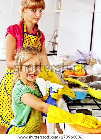 Children cleaning  kitchen. Housekeeping. - stock photo