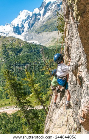 Children climbing in the high mountains - stock photo