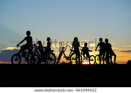Children cycling holiday evening.